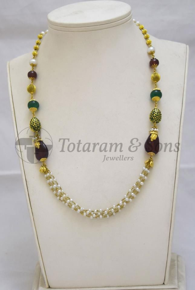 Want to flaunt a new piece of jewellery every time you attend a party? Buy this exquisite Antique Necklace delicately hand carved with Gold Balls, draped in Ruby and Emerald glass filled beads give a trendy look to the wearer.  For your desired set, Visit @Totaram & Sons Jewellers,Shop No.35, Unity House, Beside McDonald's, Opp: Grammar School, Abids Road, Hyderabad. For details, visit @ http://www.totaramsons.com/contact-us or Whatsapp @ 09885455555