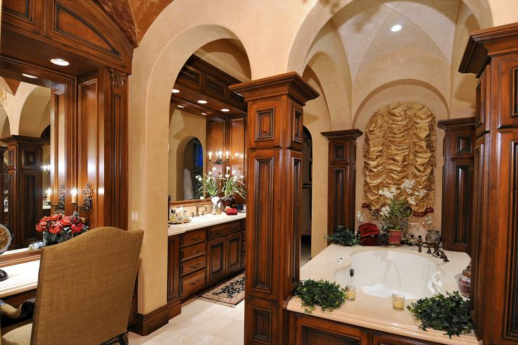 Spanish colonial estate by calvis wyant luxury homes for Spanish colonial bathroom design