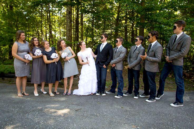 Mismatched grey bridesmaid dresses, grey & black groomsmen attire, zorro masks