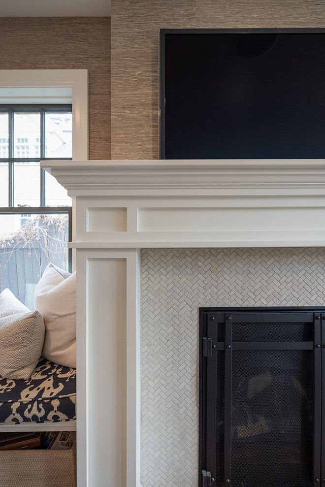 Simple Shaker style fireplace surround; love the herringbone cream tile around firebox