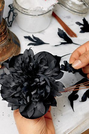 """Started in 1896, Guillet initially supplied silk, velvet and lace flowers to opera sets and store windows along the Place Vendôme. In 1981, the founder's granddaughter Marcelle Lubrano-Guillet began to create arrangements for Chanel Haute Couture. Now, the """"florists"""" can pluck from more than 10,000 designs and roughly that same number of tools to heat and shape their fine creations."""