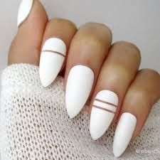These are painted nails. Their not bought!If you want to try it you will need: 1-White Nail Polish 2-Strips of thread for nails 3-Gold Nail Polish I hope you get great results
