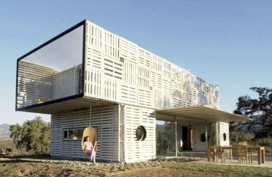 50 Incredible Homes Made Of Repurposed Shipping Containers. This one looks like is has repurposed pallet siding.