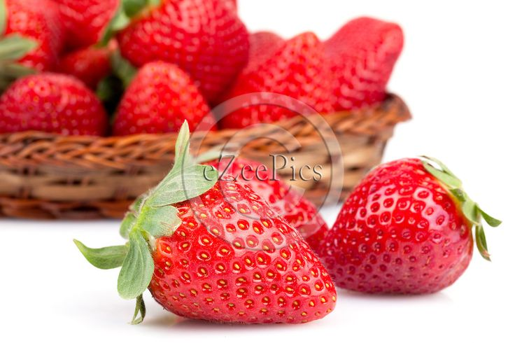 Closeup of fresh strawberries over white background.