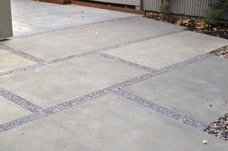 concrete patio with stone pebbles on mesh backing (available at tile stores) in between slabs