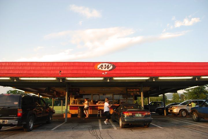 In the very early 70's my mom took us to the A&W drive through about 2 times per month. We loved the root beer in the baby mugs, and the tray that rested right on the almost all the way open car window! I always ordered a plain baby burger with onions, and onion rings!