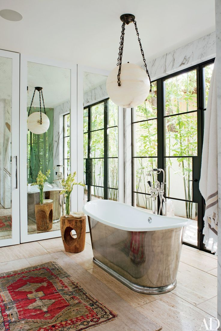 A Jf Chen Globe Lantern Hangs Above A Waterworks Tub With A Burnished Nickel Finish