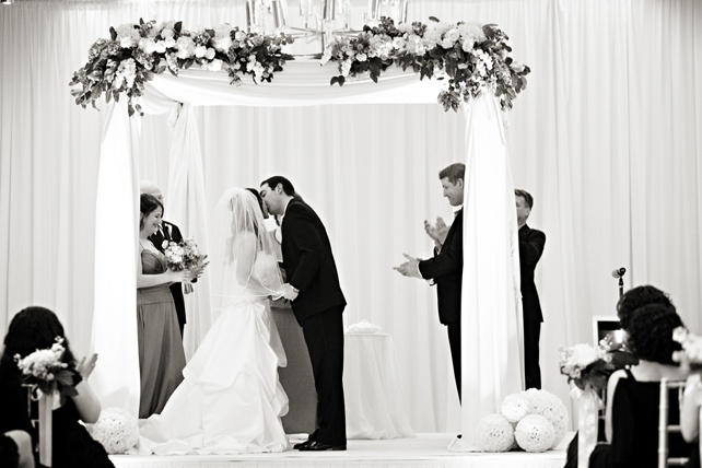 It's official!  Husband and Wife kiss under a beautiful chuppah.  (Four Seasons Hotel Baltimore)Four Seasons Hotel