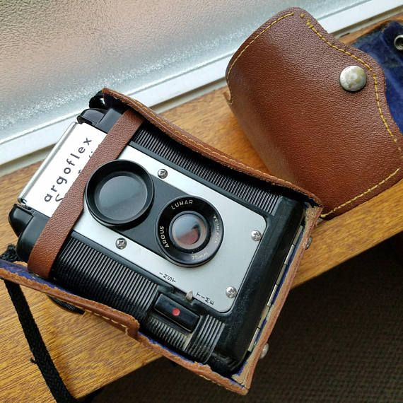 A Twin lens reflex camera manufactured by Argus during the 1940s and 1950s. It appears to be functional, however I have not ran film through it. This camera was originally made for 620 film, but can still be used with 120 film spooled on to 620 film spools. This camera comes with a beautiful Argus-branded leather field case with blue velvet interior. Camera and case do show some wear.