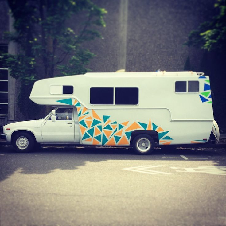 It's amazing what some white paint and vinyl decals can do for a old motorhome