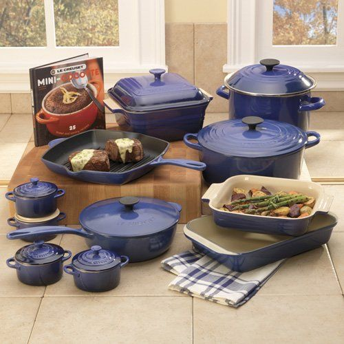 prized by international chefs le creuset 39 s porcelain enameled cast iron set retails for 700. Black Bedroom Furniture Sets. Home Design Ideas