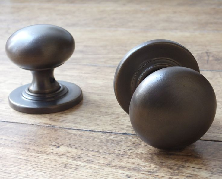 """A """"distressed antique brass"""" door knob, from British Ironmongery. Similar to antique brass, the metal is slightly """"distressed"""" rather than smooth, to give more rustic feel and appearance. These ball knobs are also available in over twenty other finishes and metals, including real, sand cast bronze. Each door knob is made in the UK and individually finished by hand. Available from - http://www.britishironmongery.co.uk/shop/bun-knob-on-covered-rose/757.htm"""