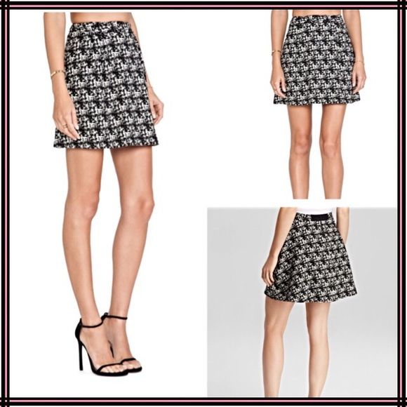 """Alice & Olivia Skirt Alice and Oliva Skirt sz L. Brand new with tag. Black and cream mini skirt with clear sequins. Mid- weight, sits at the hip and true to size. Cotton/Poly Blend. Fully lined, zips in back. 15"""" in length, 18"""" side to side. Flawless, perfect for your upcoming Holiday Party season! From a pet/smoke free home. Alice + Olivia Skirts Mini"""