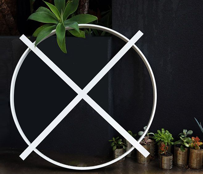 The forma cross wall art is a simple yet striking steel sculpture made for inside or outdoor spaces they can be wall mounted propped against a wall or
