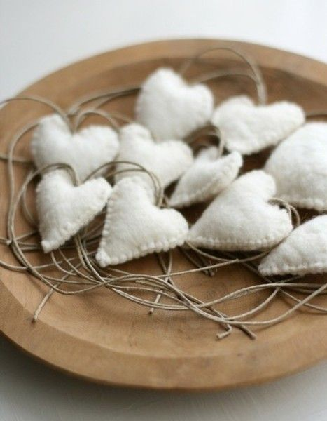 Felt hearts: Cut out Heart shapes, hand sew together, fill with soft stuff and attach a cord (or ribbon)
