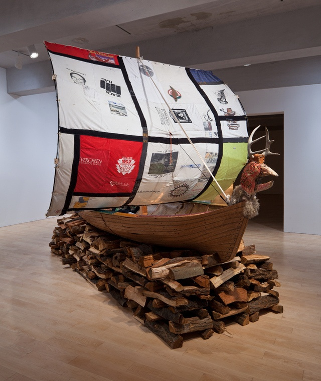 """Matthew Day Jackson, """"Sepulcher (Viking Burial Ship)"""", 2004, wood, vinyl, fabric, rope, metal, leather, plastic, fur, yarn, and found objects, installation view, Whitney Museum of American Art, New York."""