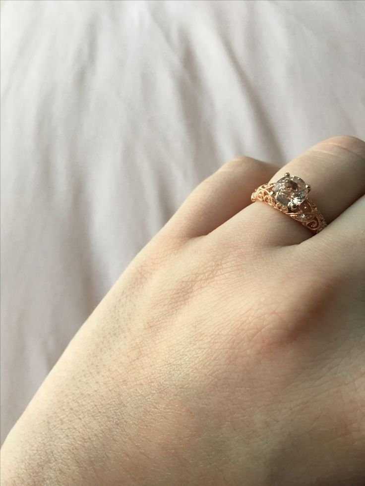Christmas engagement thanks to Shane Company! Rose gold band with a 2 karat peach sapphire. ❤