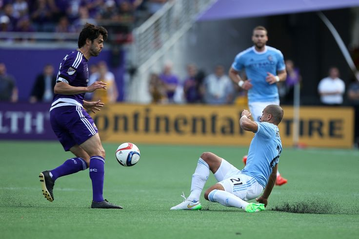 Kaka #10 of Orlando City SC and Jason Hernandez #21 of New York City FC fight for a loose ball during an MLS soccer match between the New York City FC and the Orlando City SC at the Orlando Citrus Bowl on March 8, 2015 in Orlando, Florida.
