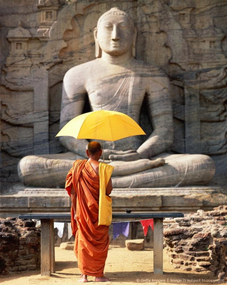 Sri Lanka, Polonnaruwa, Gal Vihara, monk in front of Buddha statue
