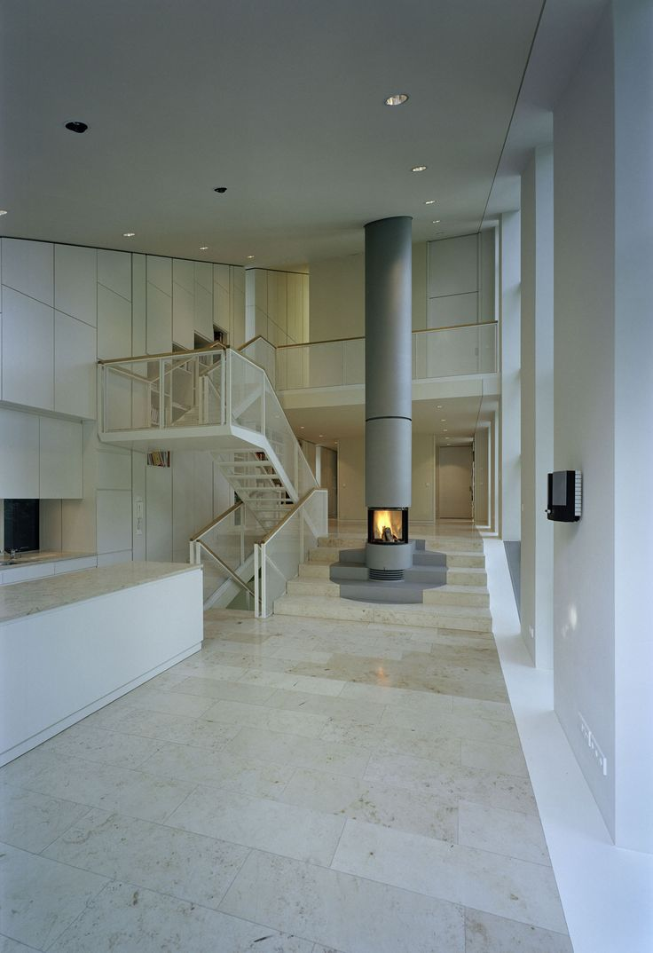 Extravagant fireplace steals the show stone fireplace for the spacious - Modern House Design With Staircase Fireplace House W By Pott Architects