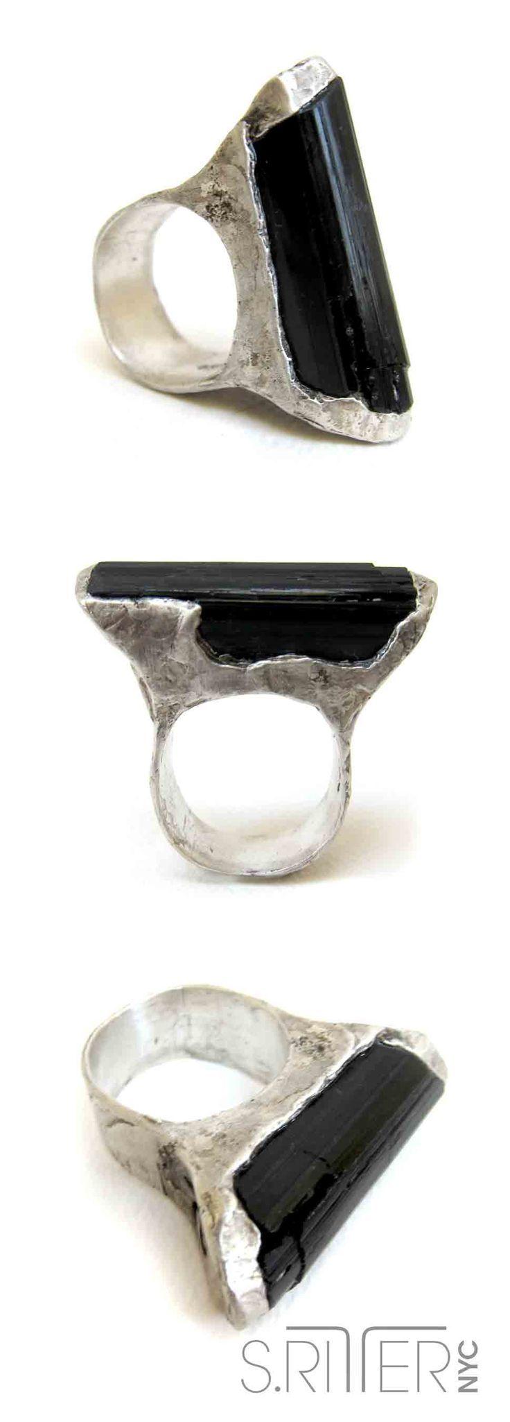 a slight, bullet-shaped piece of classy black tourmaline. sleek and sublime. ahhhh. || raw natural stone rings || http://SRitterNYC.com