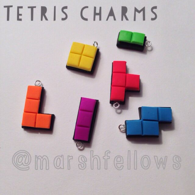 Tetris charms made from polymer clay by Marshfellows. For the Geek in you!