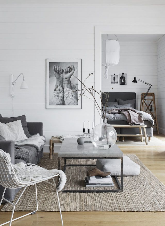 Artwork, throw blanket placement. overall color scheme and aesthetic, lamps, coffee table