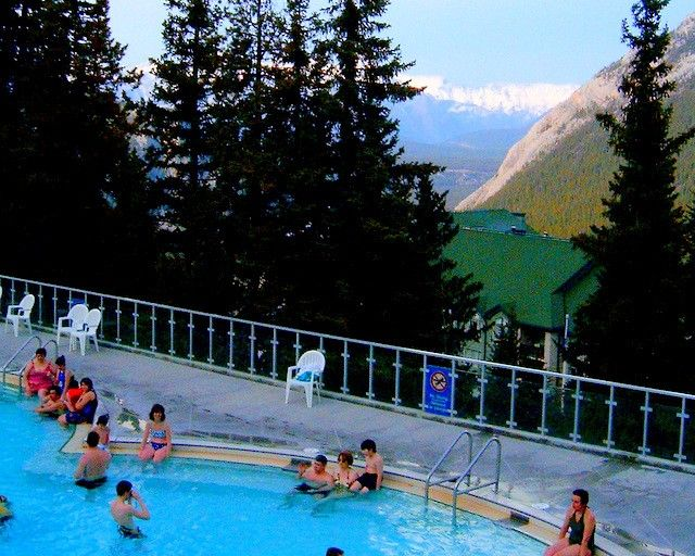 #banff Upper Hot Springs.  Enjoy a winter evening in this outdoor #hotsprings pool as snow falls all around you.