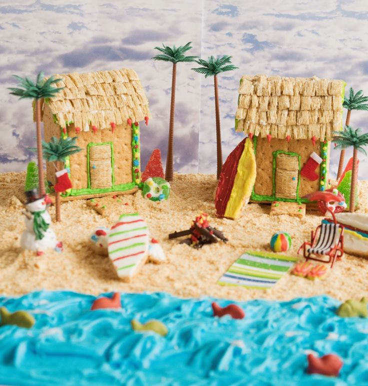 Graham cracker beach house. A beach-themed Christmas graham cracker beach house & peanut butter cookie surfboards.
