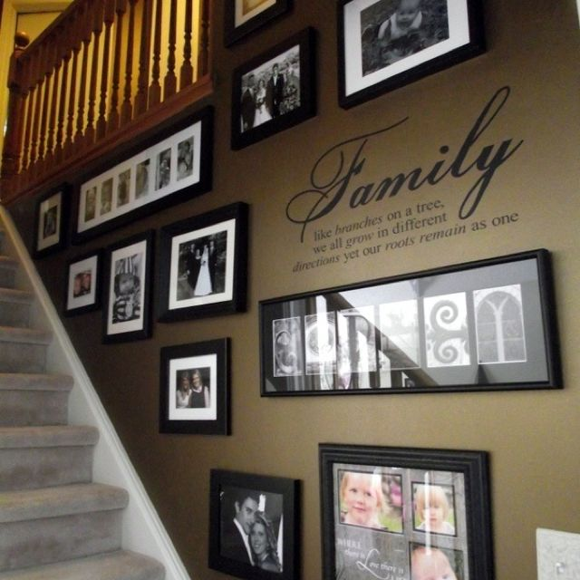 Staircase Decor: Beautiful way to showcase family. Are you remodeling? Let us be a resource. www.boardwalknorth.com