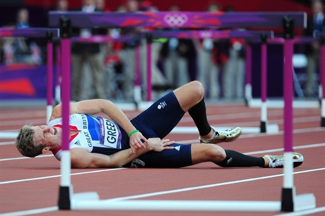 Jack Green of Great Britain lies after falling in the Men's 400m Hurdles Semi Final