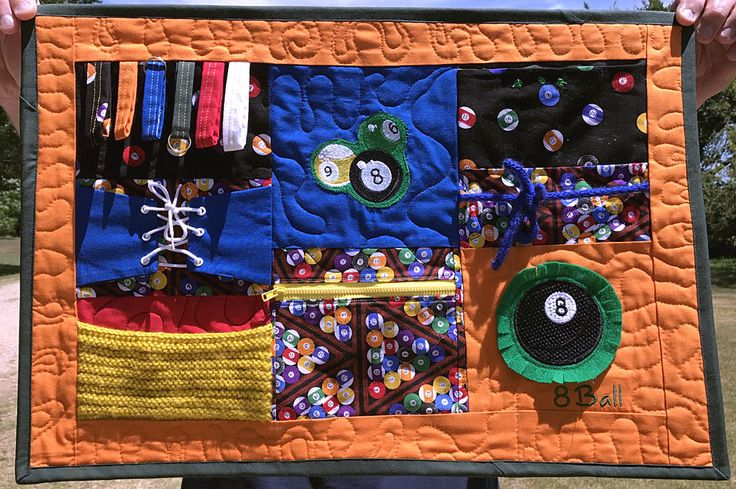 Billiard Fidget Mat for people with Dementia and other brain disorders.  Our Billiards Fidget Quilt Collection is available in wheelchair size and mat size. Both sizes contain an inside fabric to make them not only warmer but also sturdier and less likely to slip off of your loved one.   https://www.facebook.com/pg/FidgetFingers/photos/?tab=album&album_id=1911496825765416