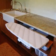 interesting way to store the ironing board plus a farmhouse sink in the utility room would be great !