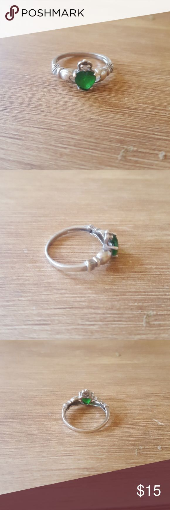 Silver claddagh ring with emerald stone This is a size 6 silver claddagh ring with a emerald center stone. There is a clear crystal at the top as well. It was a gift so I am unsure of the original price. Jewelry Rings