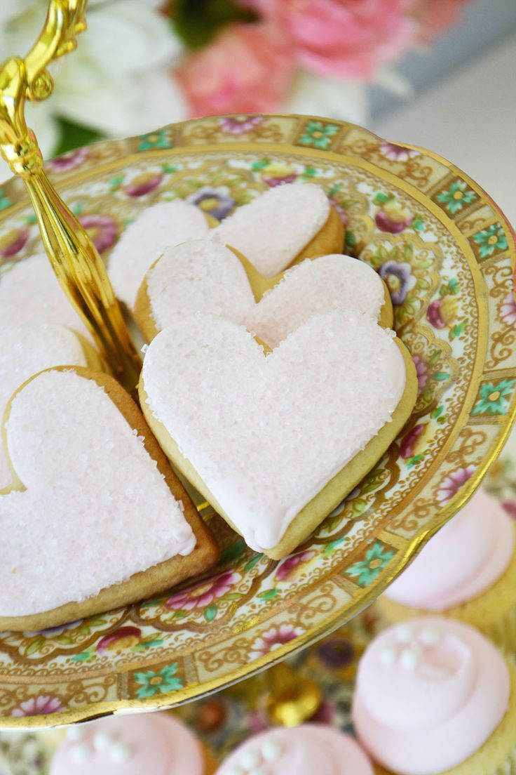 Adorable sparkling heart sugar cookies by Bake Sale Toronto. Tiered cake stand from Vintage Dish Rental.