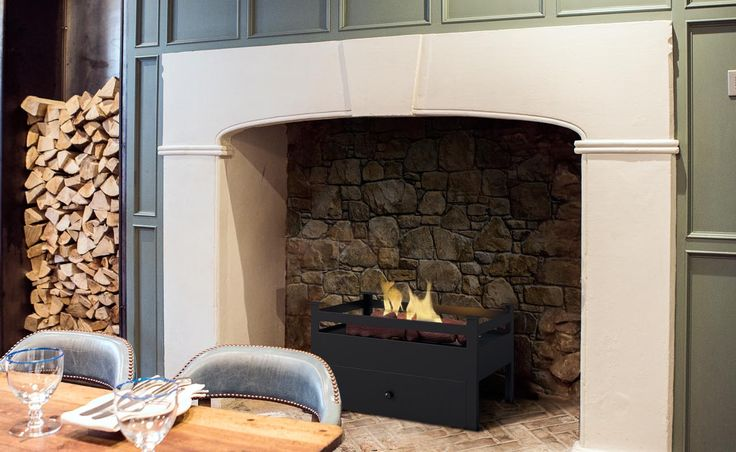 The Arkle bioethanol fireplace is one of the new fire baskets from imaginfires.co.uk.  These are perfect for those who have an unused fireplace. It just drops in to your fireplace. It doesn't require a chimney or flue, as it doesn't emit soot or smoke but you will still get real flames and real heat.