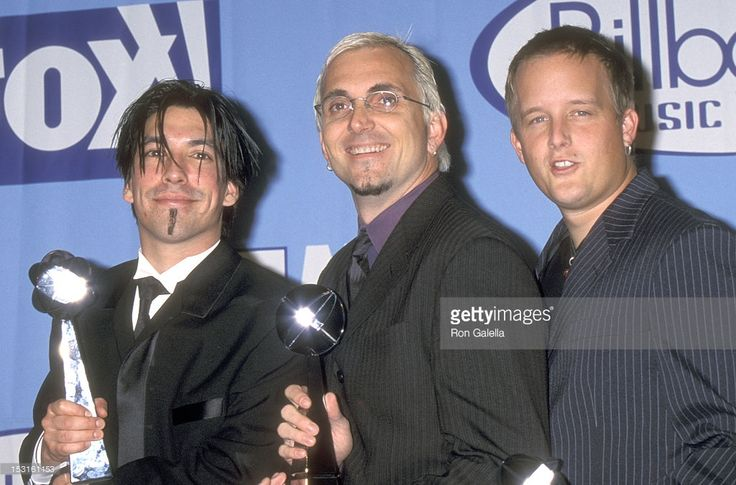 Musician Craig Montoya, musician Art Alexakis and musician Greg Eklund of rock band Everclear attend the Ninth Annual Billboard Music Awards on December 7, 1998 at MGM Grand Garden Arena, MGM Grand Hotel and Casino in Las Vegas, Nevada.