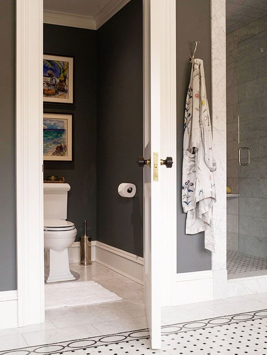 Dark Walls with Splashy Art in Private Toilet Room or Powder