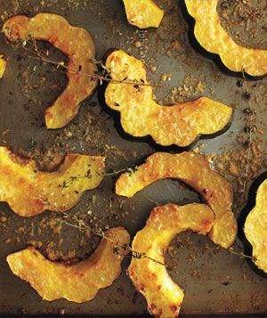 "{ Parmesan-Roasted Acorn Squash } Heat oven to 400°. Halve, seed and slice to 3/4"" thickness one 2-lb acorn squash. On a rimmed baking sheet, toss the squash with 2 T olive oil, 8 sprigs fresh thyme, ½ tsp salt, and ¼ tsp pepper. Sprinkle with ¼ cup grated Parmesan. Roast squash until golden brown and tender, 25 to 30 minutes."