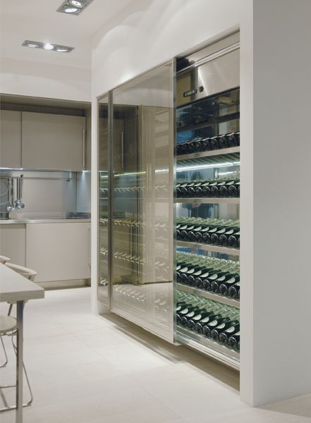 VINA, wine storage unit, with refrigerating units that keep the internal temperature between 12 and 14°C and relative humidity % >70%, coplanar doors, wine shelves in stainless steel and Stopsol double-glazed doors. LED internal lighting with volumetric sensor that switches on when the door is opened.