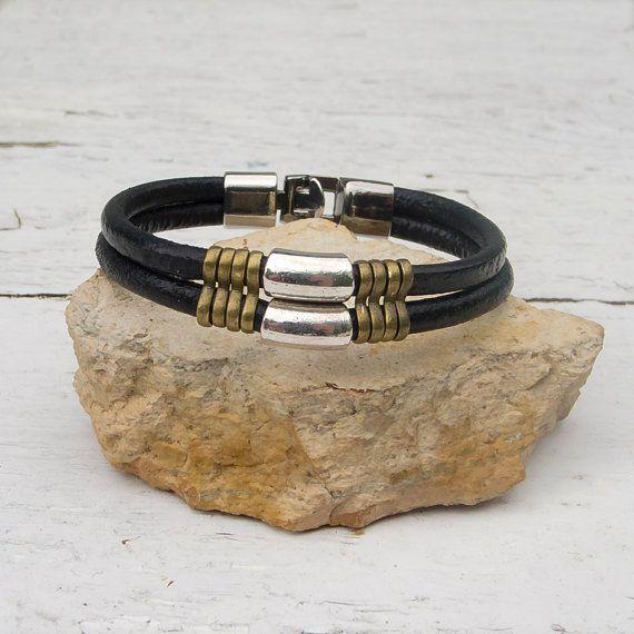 Mens leather bracelet Men's tribal bracelet Black round by Jullyet, $28.00 5 mm black round genuine leather, silver tone tube beads, bronze slider spacers