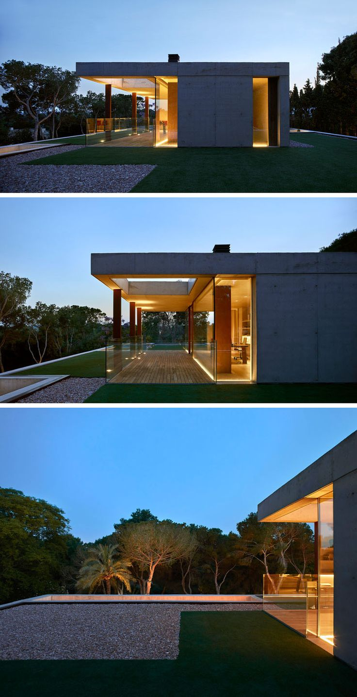 On the top of this modern house there's a room that's been set up as an office that has views of the surrounding landscape.