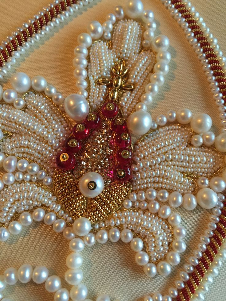 My latest embroidery (Larissa B.) Detail of pomegranate flower. Worked in freshwater pearls, red spinel beads, purl, etc. Free design by Mary Corbet. NeedleandThread