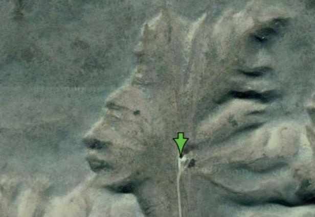 The Badlands Guardian : This natural formation in Alberta, Canada is known as the Badlands Guardian and looks strikingly similar to a native American wearing a headdress. If you look close enough, it looks like he's wearing a pair of earphones, but that section is actually a man-made road and oil well.
