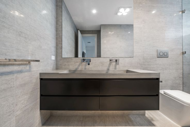 stunning black vanity unit with concrete benchtops