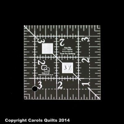62. Quilting Square Ruler: (non-slip) 3 1/2″ This Quilting square Ruler works with the 3 1/2″ by 6 1/2 rectangle and the 6 1/2″ square to create a variety of quilting blocks.  Non-slip, 3mm thick, clear hard wearing acrylic, laser etched and cut for accuracy.  For use with rotary cutters.  The ideal size for everyday patchwork.  Large easy to read numbers which will never come off.  The white squares are special non-slip features.