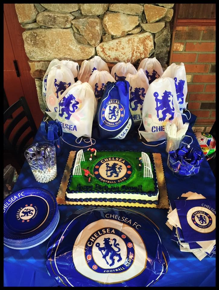 Chelsea FC party for my 6 year old. Cut out logo from print and traced on bags, colored in with marker. Bought soccer balls in bulk (15) for $50 and put them in the bags as gifts. Bought logo for cake and had made a local grocery store. All plates, napkins and balloon bought online.