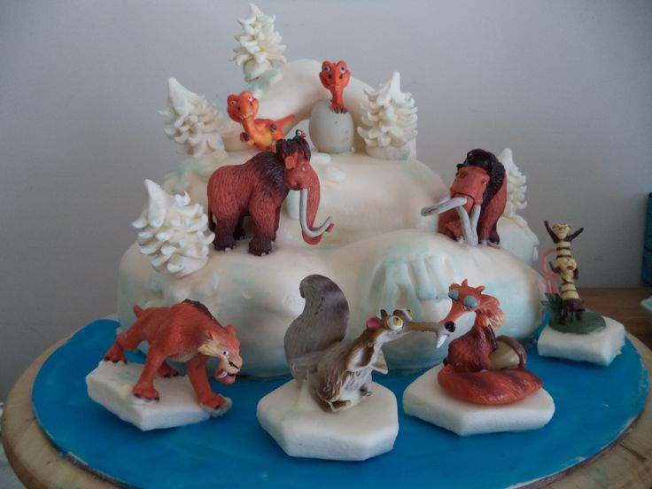 - My sons ice age cake. Chocolate cake filled with peppermint SMB and iced in ganache and Michelle Fosters Fondant. Figurines were bought. (I'm glad I bought them and didn't make them like I originally intented. There is just not enough hours in a day).