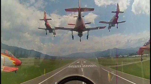 The Spanish Air Force's Patrulla Aguila land in a seven ship formation.