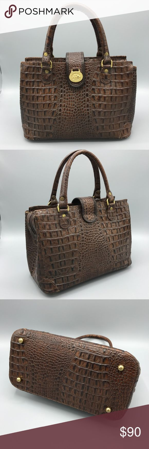 """Brahmin Classic Brown Small Satchel Zip Top EUC Vintage Brahmin. Gently Preloved.  Exquisitely crafted in luxurious croc-embossed leather, this Brahmin carryall offers intuitive organization in a classic, structured silhouette that never goes out of style - Melbourne style satchel.  Leather Small sized bag: 11"""" W x 7"""" H x 5-1/2"""" D 4-1/2""""L double handles Top zip closure Exterior features gold-tone hardware Interior features 1 zip pocket, 2 organizer pockets, key clip and pen loops  Clean and…"""